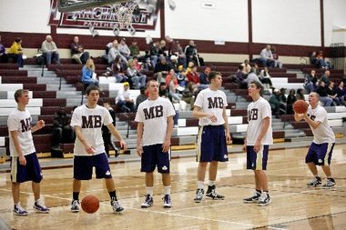 Mikey's old high school team supported him by wearing T-shirts with his initials!